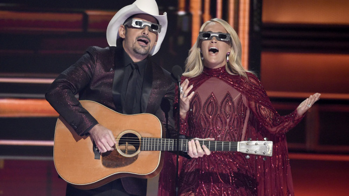Mandatory Credit: Photo by Invision/AP/REX/Shutterstock (9213026c) Brad Paisley, Carrie Underwood. Hosts Brad Paisley, left, and Carrie Underwood speak during the 51st annual CMA Awards at the Bridgestone Arena, in Nashville, Tenn APTOPIX 51st Annual CMA Awards - Show, Nashville, USA - 08 Nov 2017